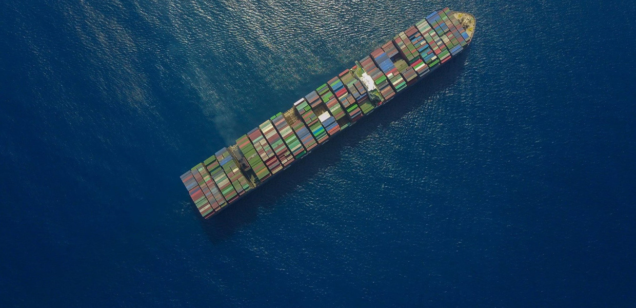 A container ship at sea, photographed from the air