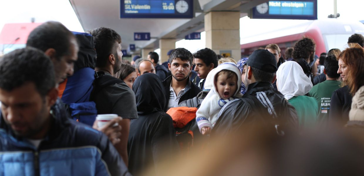 Syrian refugees are waiting in Vienna railway station.