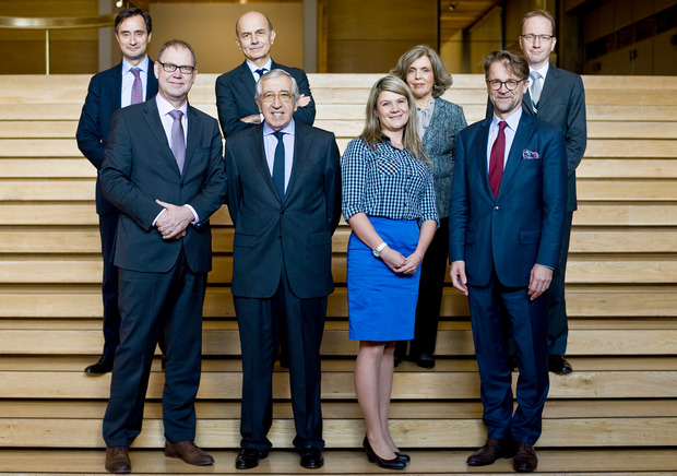 Representatives of the foundations and think tanks participating in the Vision Europe Summit pose for a group photo on a stairway.