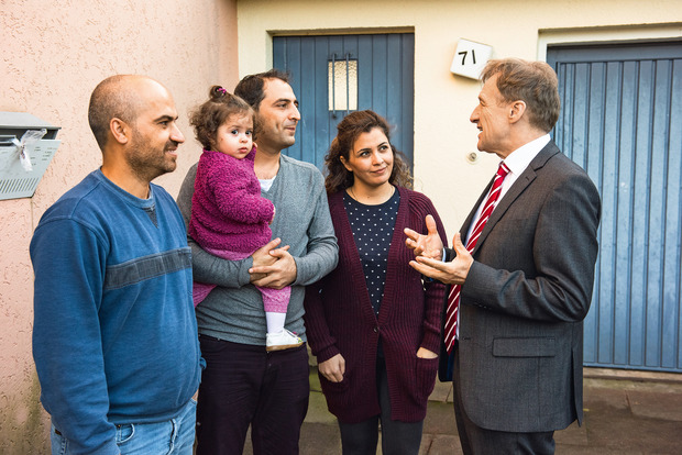 A family of Syrian refugees in front of their home in Münster.