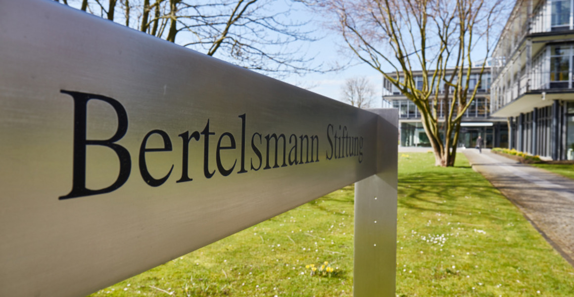 "A sign standing in front of the Bertelsmann Stiftung's main entrance reads ""Bertelsmann Stiftung""."