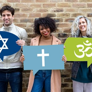 Five people are holding signs carrying the symbols of Islam, Christianity, Judaism, Hinduism and Buddhism.