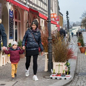 A man, a woman and a child walk through the historical city of Berlin Spandau.