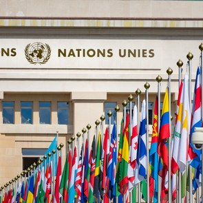 [Translate to English:] United Nations Building and the flags in Geneva Switzerland