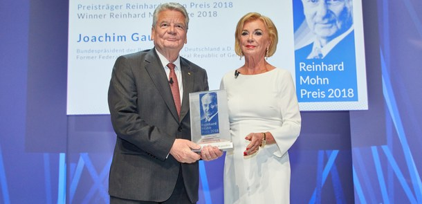 Liz Mohn, Vice Chairman of the Bertelsmann Stiftung Executive Board, presents the Reinhard Mohn Prize to former German President Joachim Gauck on the stage of the Gütersloh Theatre.