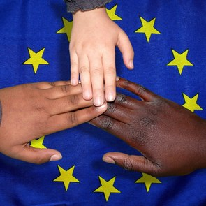 3 hands of different nations united over the European flag